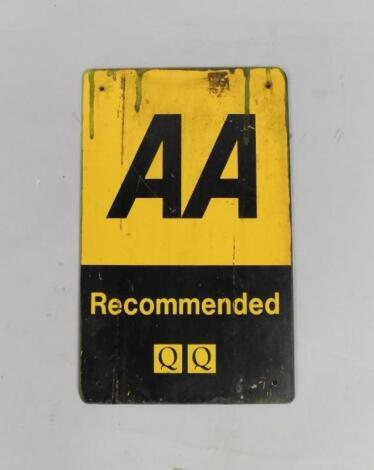 An AA Recommended QQ black and yellow metal wall plaque