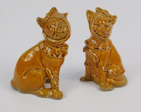 A late 19thC grotesque pottery cat and dog pair