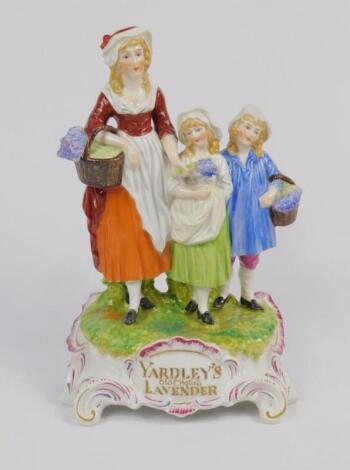 A Dresden porcelain advertising figure group