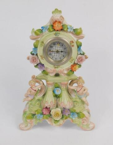 A Continental early 20thC porcelain mantel clock