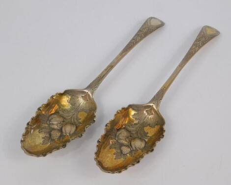 A pair of George II silver fruit spoons