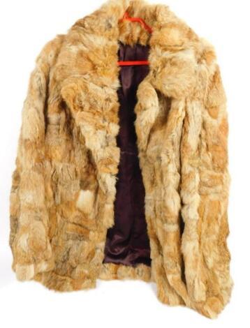 A Korean rabbit fur coat size 16.
