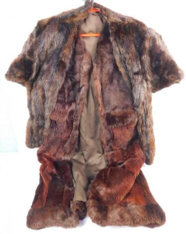 A fur lined wool gillet and a mink wrap.