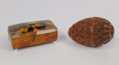 A carved Coquilla nut egg form box