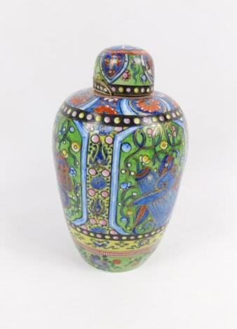 A 19thC tin glazed earthenware ginger jar and cover