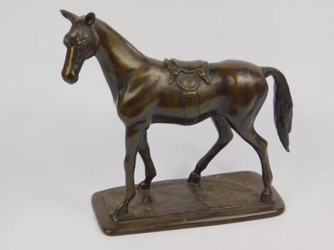 A loaded bronze figure of a horse