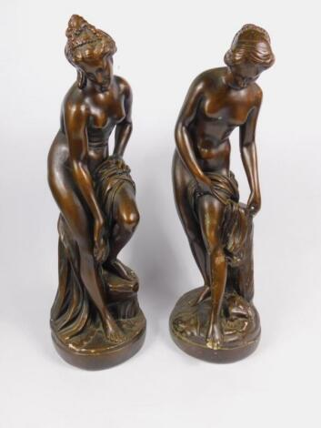 A pair of late 19thC bronzed plaster figures modelled on Venus bathing
