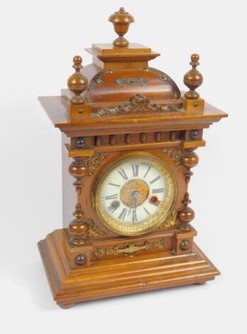 A Hamburg American Clock Co late 19thC walnut cased mantel clock