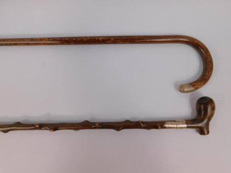 A Victorian hazel wood walking stick with a white metal belt collar
