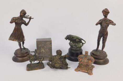 A pair of cast metal figures modelled as musicians