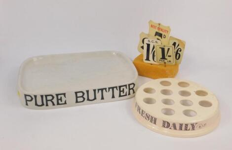 A Parnell & Sons Ltd white glazed pottery 'Pure Butter' advertising stand