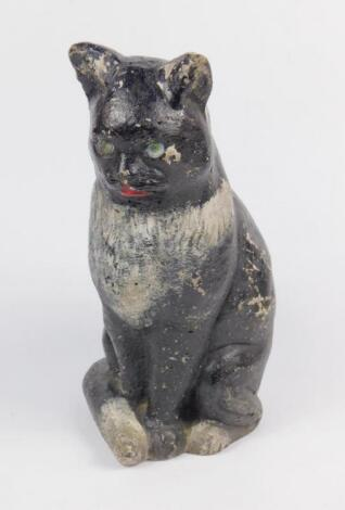 A plaster early 20thC figural door stop modelled as a seated cat