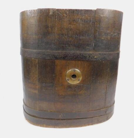 An oak and iron bound cooper's barrel oval stick stand