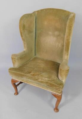 A Queen Anne walnut framed library wingback chair