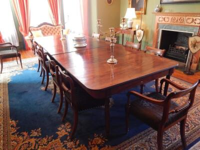 A George III mahogany extending dining table