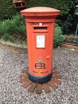A red cast iron Edward VIII Post Office post box of pillar form.