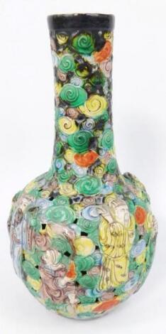 A 19thC Chinese reticulated famille verte porcelain bottle vase