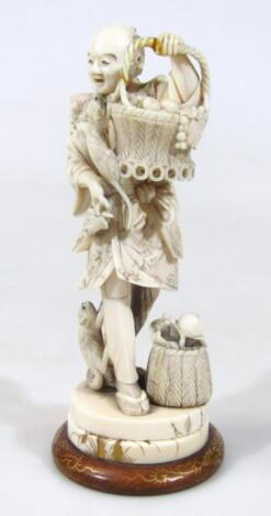 A Japanese Taisho period ivory figure of a gentleman