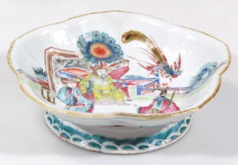 A Chinese semi-porcelain Kangxi style dish