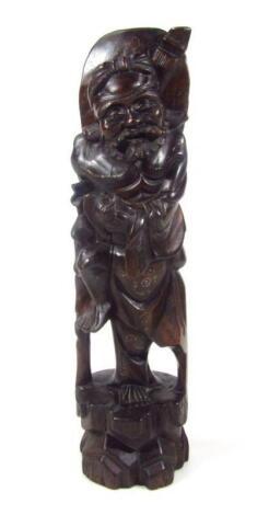 An ebonised carved hardwood figure