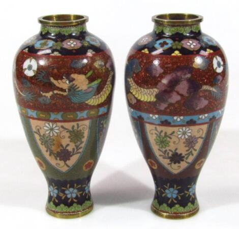 A pair of 20thC Chinese cloisonné vases