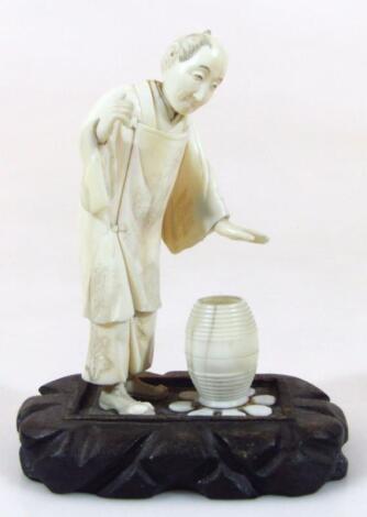 A Taisho period Japanese ivory figure group