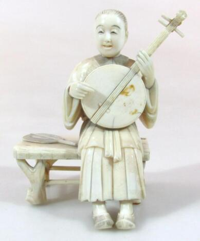 A Japanese Taisho period Tokyo style ivory figure group