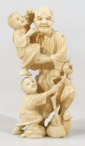 A Japanese late Meiji period ivory figure group
