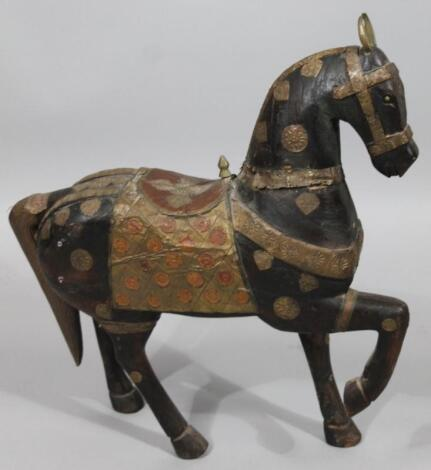 An Arabian carved wooden figure of a horse