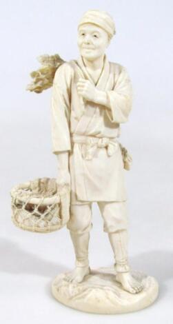 A Japanese Meiji period carved bone figure