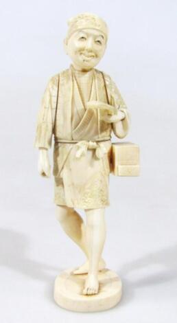 A Japanese Meiji period ivory figure