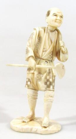 A Japanese Taisho ivory figure of a gentleman