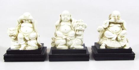 Three polished figures of Buddha
