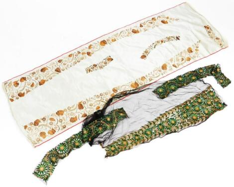 A cream silk banner or throw