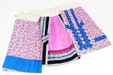 Various oriental silk skirts and material