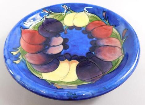 A Moorcroft Wisteria pattern shallow dish
