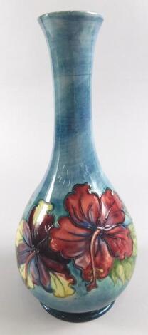 A Moorcroft floral pattern bottle shaped vase