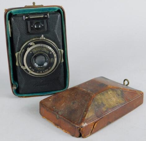 A Zeiss Ikon Compur camera and leather travelling case