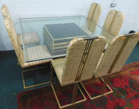 A 1970/80s gold coloured tubular dining table