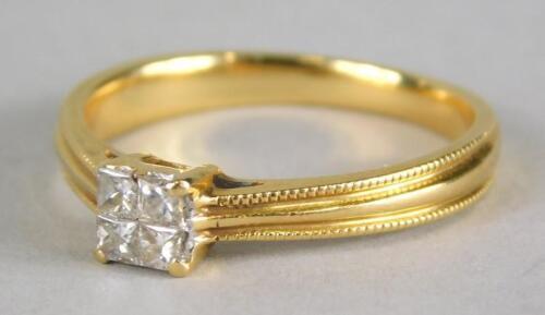 An 18ct gold diamond set dress ring