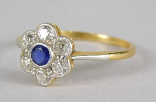 A sapphire and diamond floral cluster ring