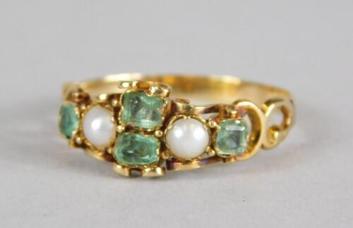 An emerald and seed pearl dress ring
