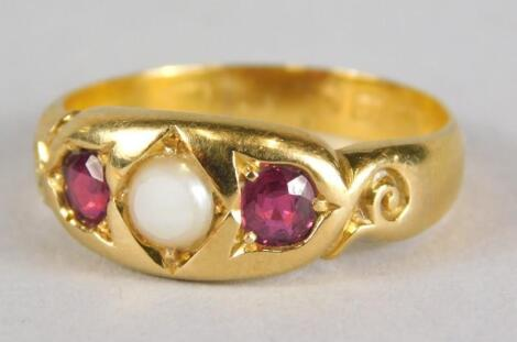 A 22ct gold ruby and pearl set gypsy ring