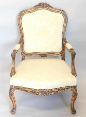 A French style walnut fauteuil