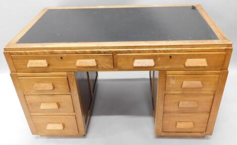 An early to mid 20thC beech and ash kneehole desk