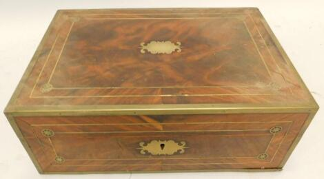A 19thC figured mahogany and brass bound campaign style writing box