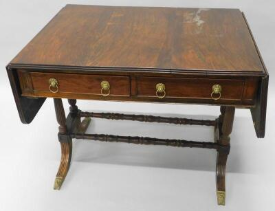 An early 19thC rosewood sofa table