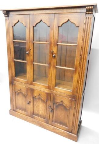 A distressed oak display cabinet