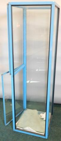 A blue painted shop display cabinet