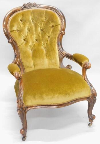 A Victorian walnut show frame open armchair